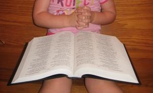 A child prays.